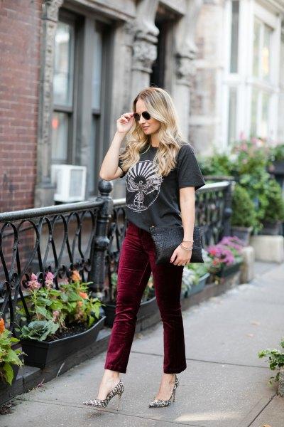 black graphic t-shirt with burgundy velvet pants