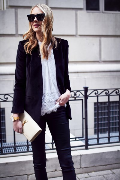 black oversized velvet jacket with white tunic top made of lace and slim jeans