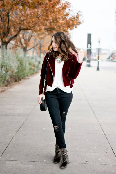 black short jacket with white chiffon blouse and torn jeans