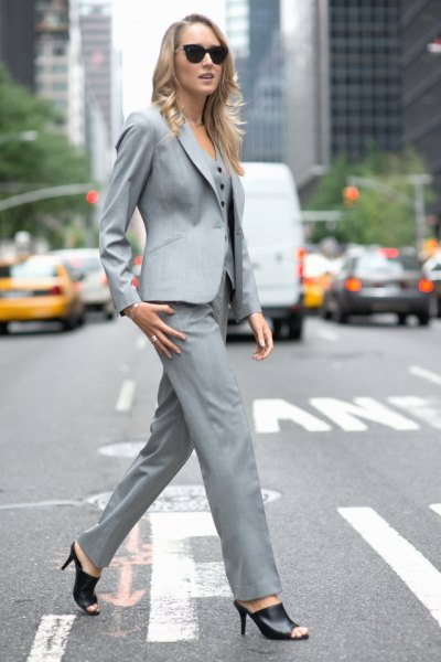 gray matching suit with black short boots with open heels
