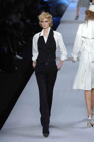 black suit vest with white shirt and suit pants
