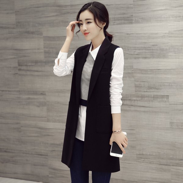 black longline vest with white tunic shirt and gray mini vest