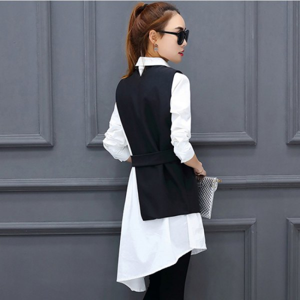 black suit vest with white tunic shirt dress and jeans