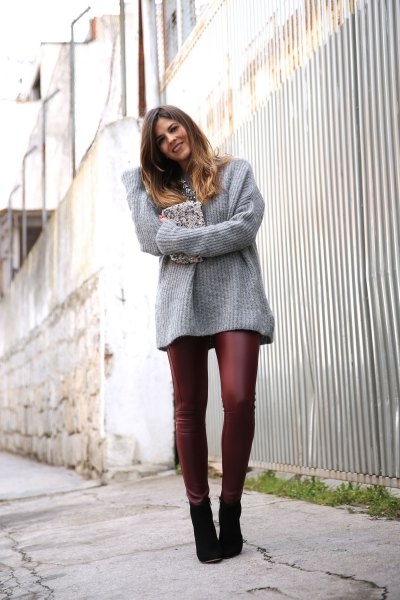 gray, ribbed, thick sweater with burgundy leather leggings