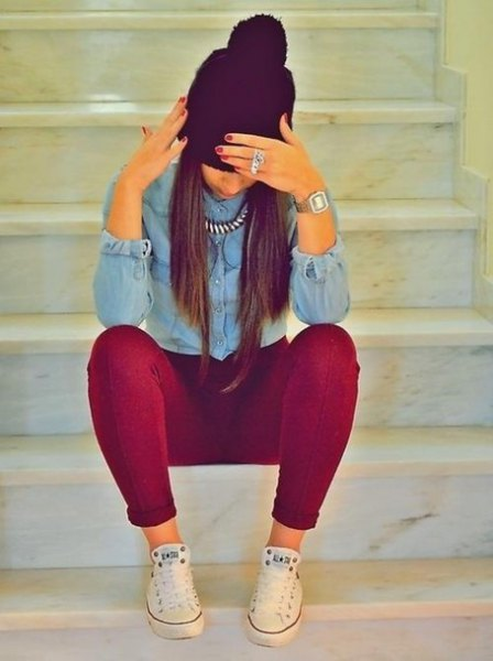 Light blue chambray shirt with buttons and burgundy super skinny jeans