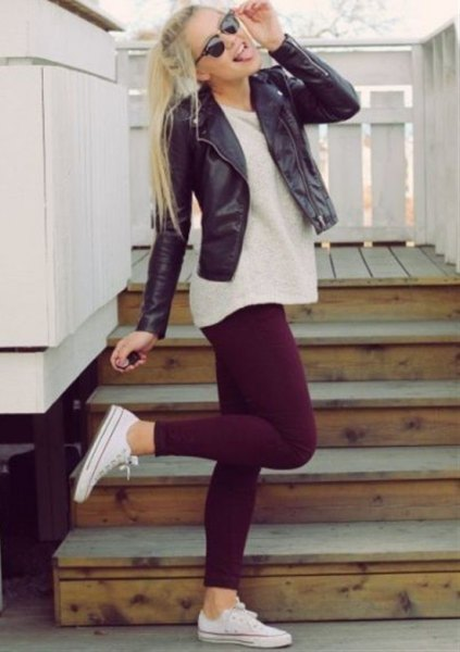 black leather jacket with light pink tunic sweater and leggings