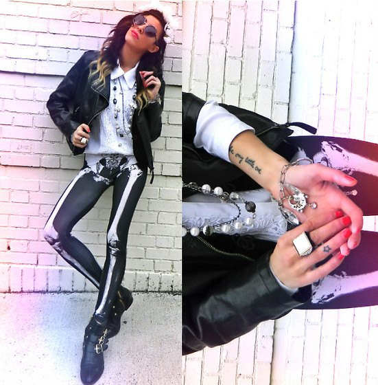 black leather bomber jacket with white collar shirt and skeleton gaiters