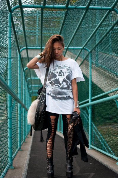 white oversized graphic t-shirt with black leggings and boots