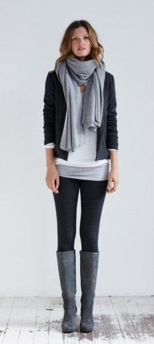 white and gray tunic top with black blazer and knee-high boots