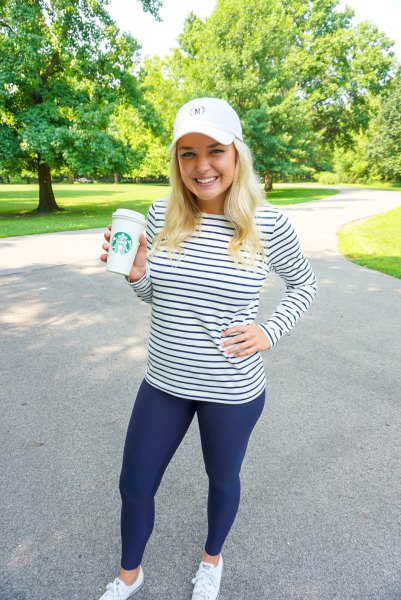 dark blue and white striped long-sleeved T-shirt with tights and baseball cap