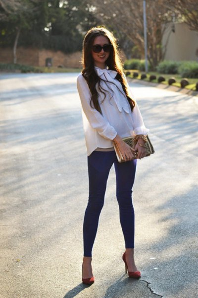white chiffon blouse with dark blue leggings and burgundy heels