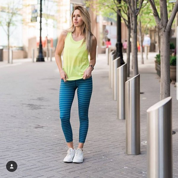 yellow tank top with black and white horizontally striped leggings