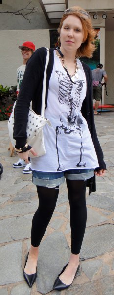 graphic t-shirt with white tunic, denim shorts and black footless tights