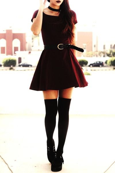 black t-shirt with belt skater skirt and tights