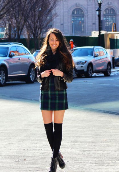 black leather jacket with dark blue checked mini skirt and ankle boots