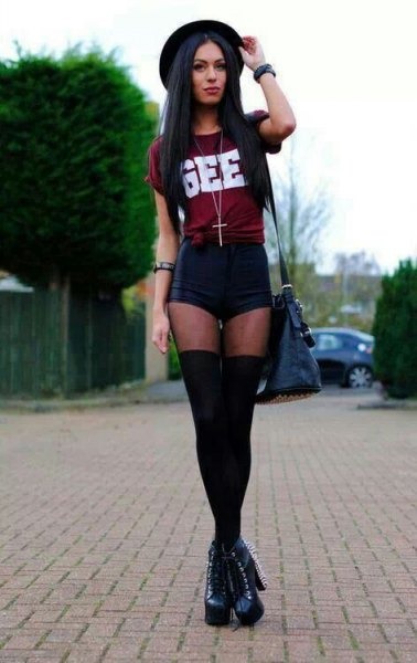 Burgundy knotted t-shirt with black mini shorts and tights