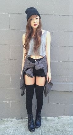 gray short tank top with black mini denim shorts and boots