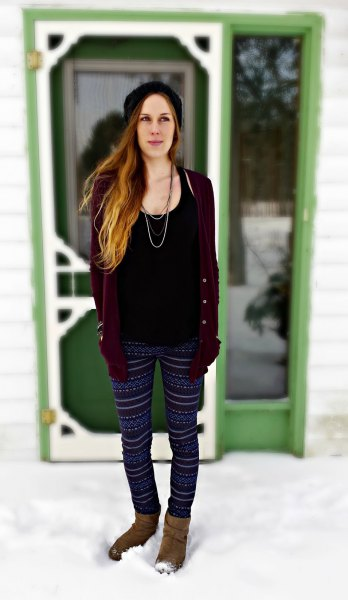 black tank top with a scoop neck, cardigan and tribal fleece leggings