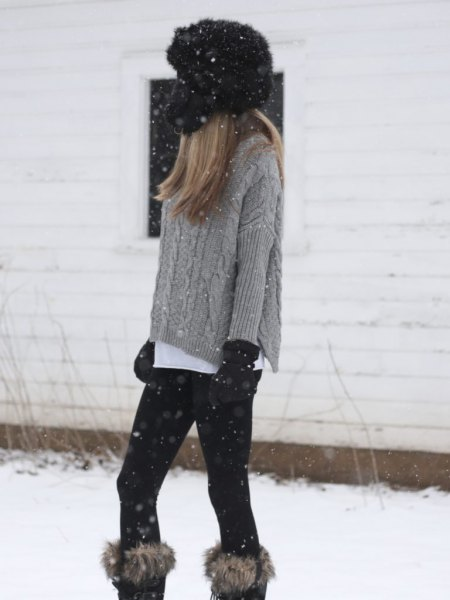 gray, coarse-grain knit sweater with knee-high boots made of faux fur