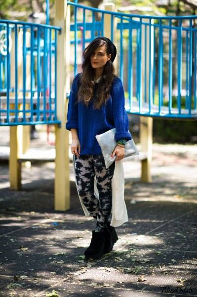 royal blue blouse with a relaxed fit and black and white leggings