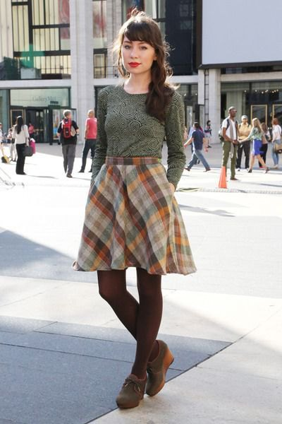 gray fitted sweater with checkered flared mini skirt