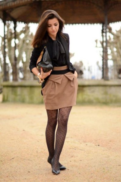 black tie blouse with red mini skirt and dotted tights
