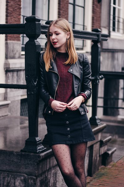 black leather biker jacket with mini skirt and dotted tights