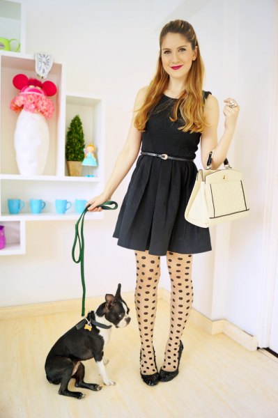 black mini hangover dress with tank belt, dotted stockings and ballerinas
