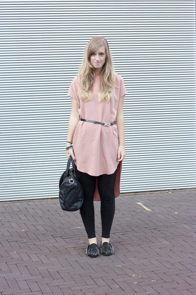 Light pink tunic top with belt, black leggings and spiked loafers
