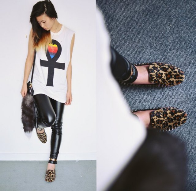 white sleeveless graphic t-shirt with black leather leggings and loafers with leopard print