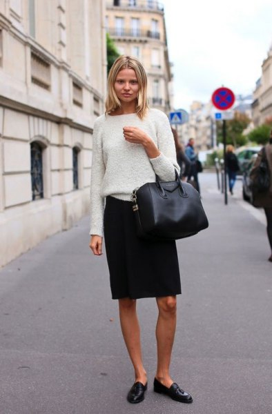 white sweater with black knee length skirt and leather penny shoes