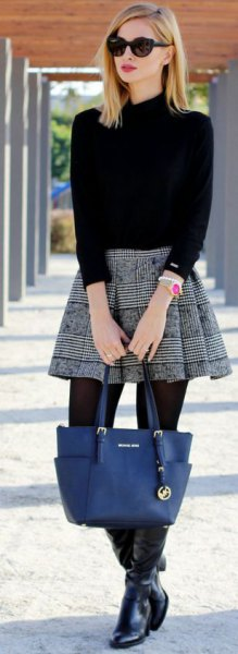 black mock neck sweater with mini rat skirt
