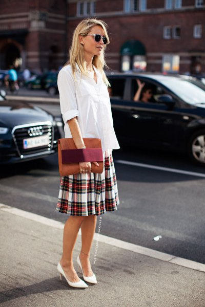 white blouse with button closure and checkered skirt with a relaxed fit
