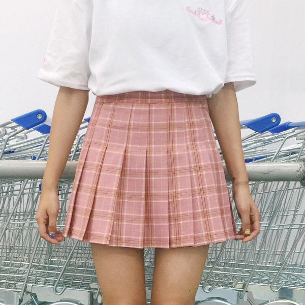 pink pleated plaid skirt with white t-shirt with wide sleeves