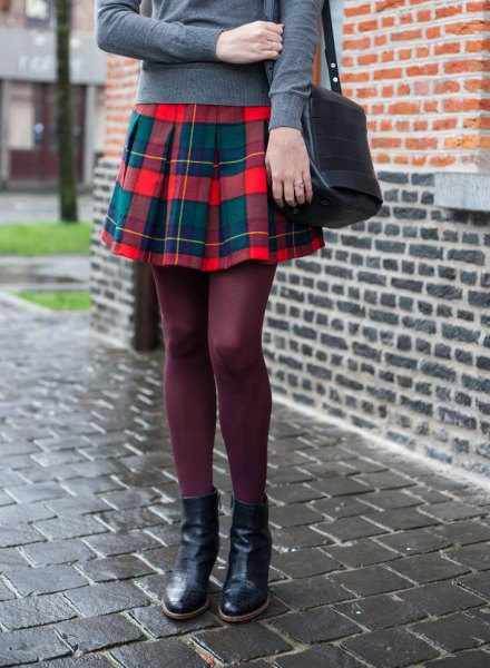 gray sweater with red flannel pleated mini skirt