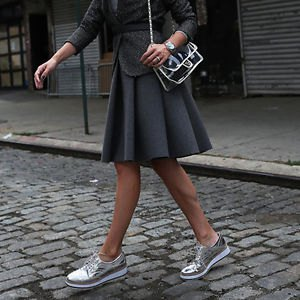 gray pleated wool mini skirt with silver sneakers