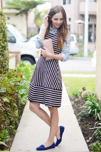 light blue shirt with buttons and black and white striped tank mini dress