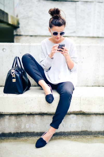 white sweater with a relaxed fit, coated jeans and royal blue loafers