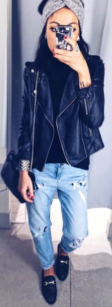 black leather jacket with boyfriend cuff jeans and royal blue loafers