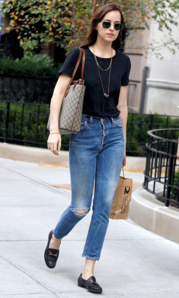 black T-shirt with blue, slim fit ankle jeans and loafers