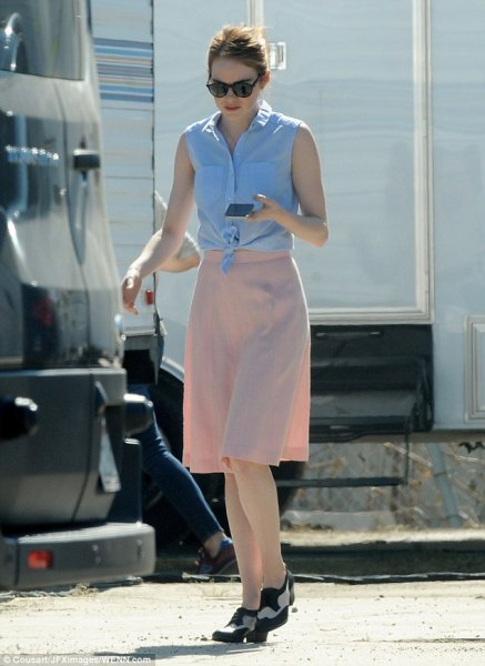 sky blue knotted sleeveless shirt with knee-length chiffon skirt in pink and loafers