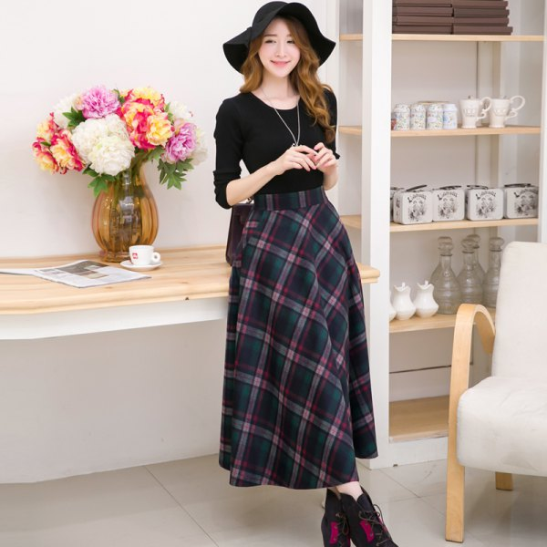 black long-sleeved t-shirt with a scoop neck and a maxi-gray checkered wool skirt