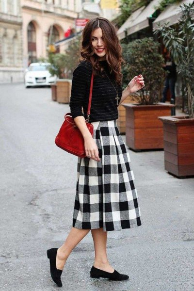 Knitted sweater with black and white midi wool skirt