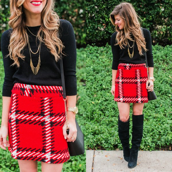 black sweater with three-quarter sleeves and red mini skirt made of checkered wool with high waist