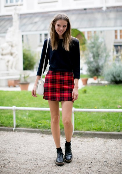 black sweater with red checkered high rise mini skirt