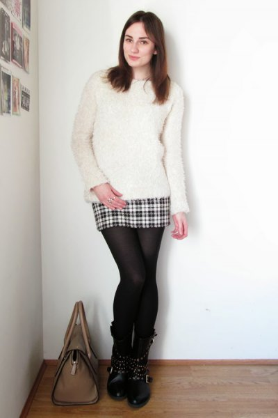 white fuzzy sweater with mini plaid skirt made of wool and stockings