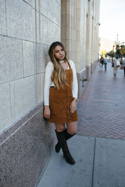 brown corduroy midi dress with white sweater and black over the knee boots