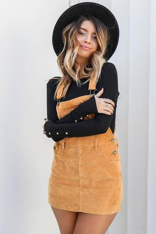 black sweater with camel dress and felt hat