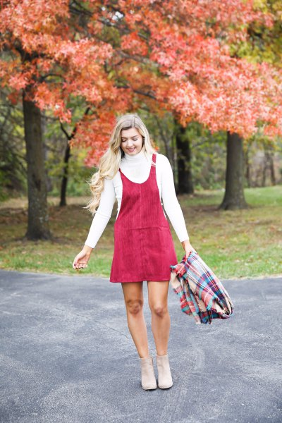 red mini cord swing dress with scoop neck and white mock neck sweater