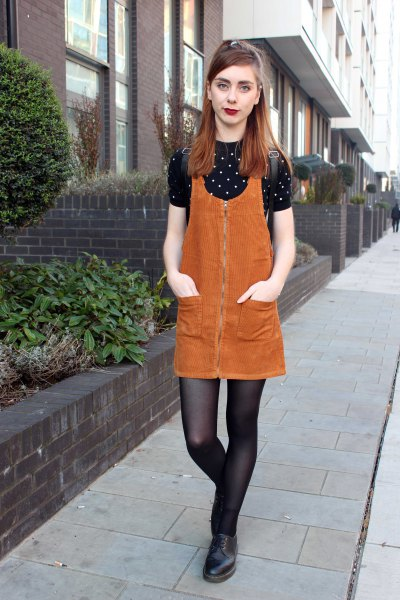 orange cord dress with black and white polka dot shirt